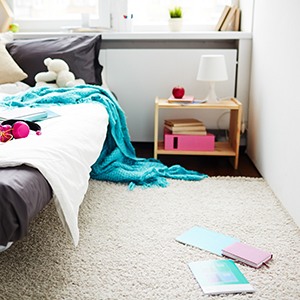 A teenages carpeted bedroom